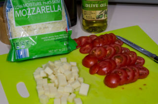 sliced tomato, cubed cheese, and shredded mozzarella