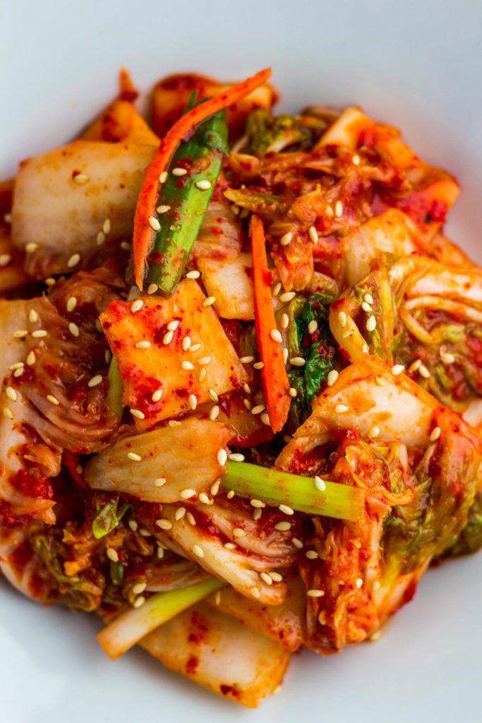 Close up shot of freshly made korean vegan kimchi with sprinkle of sesame seeds