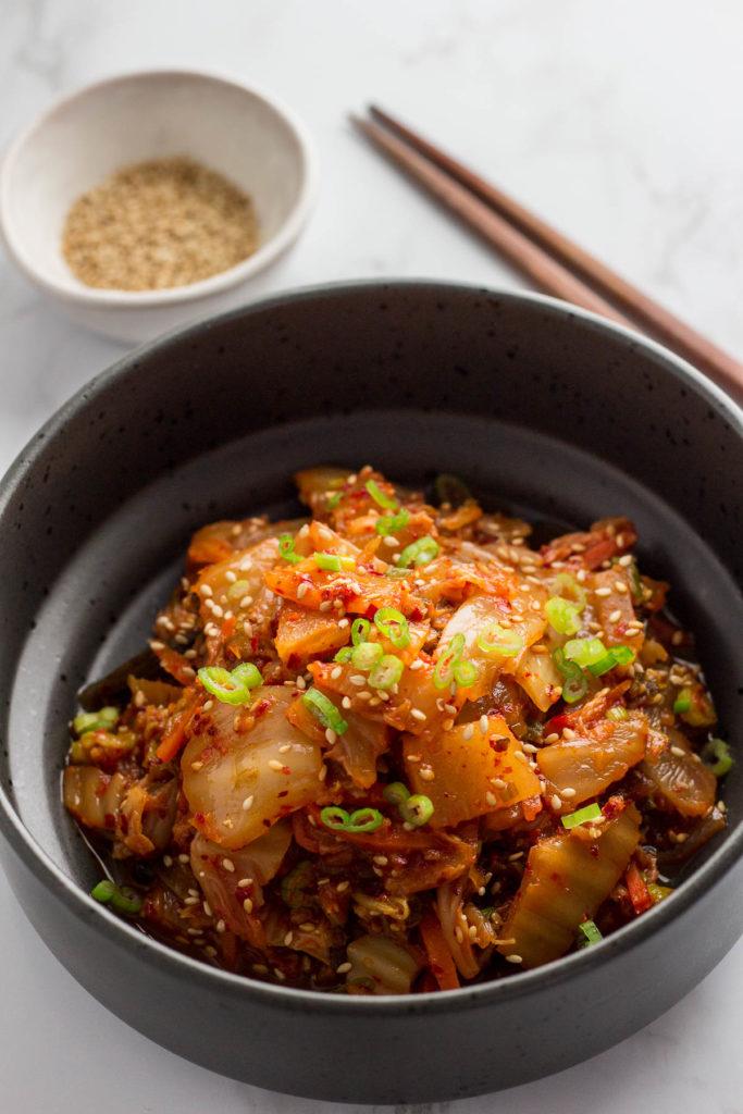stir fried kimchi in a black bowl