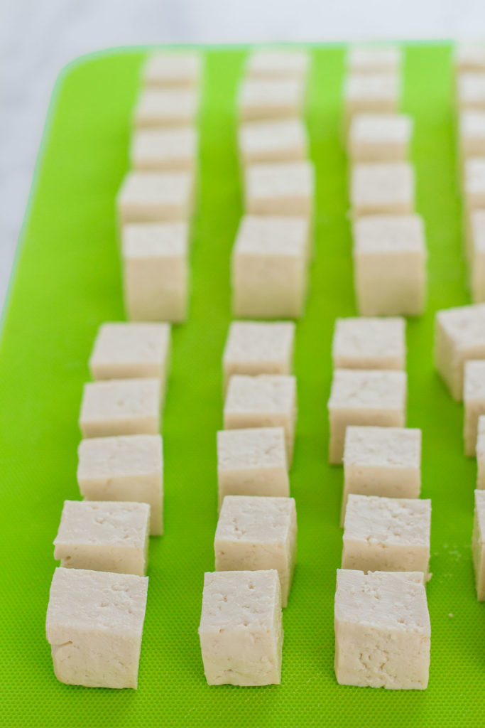 Tofu cubes on the cutting board