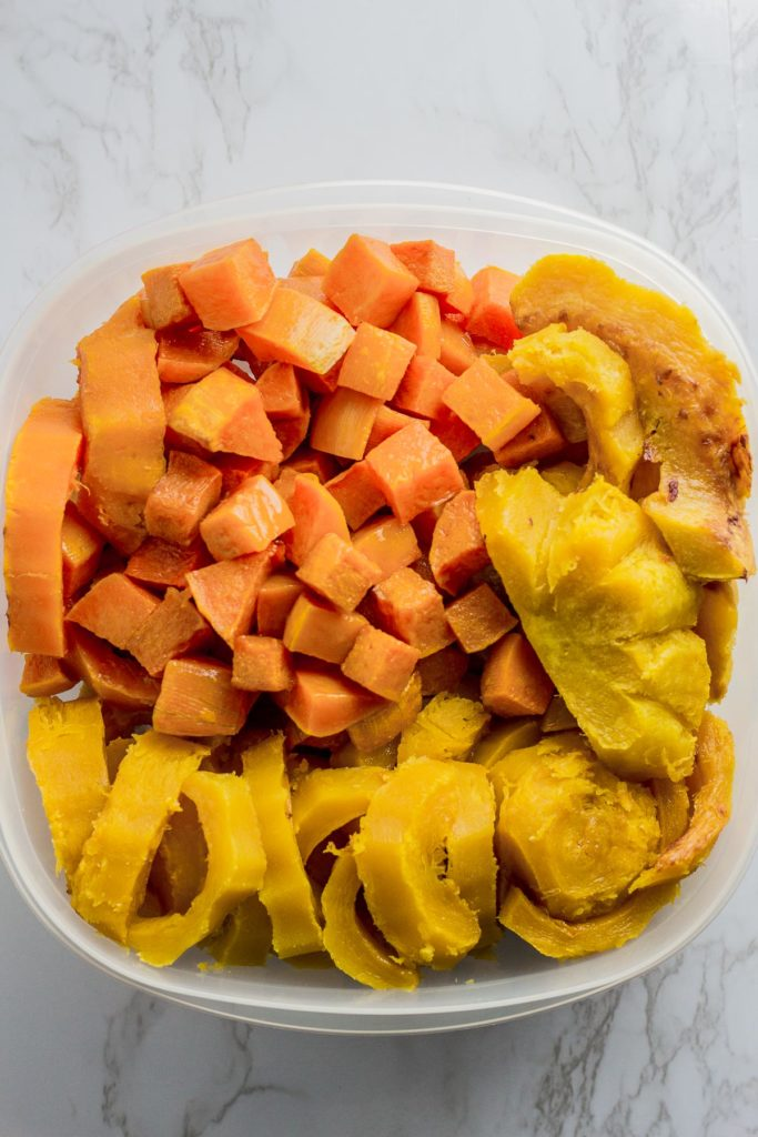 Baked acorn, butternut, and delicata squash with their skin removed and placed in a big container