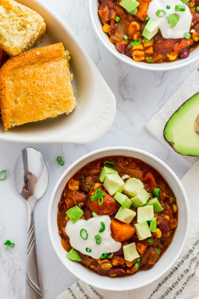 Over head shot of two bowls of chili and corn bread