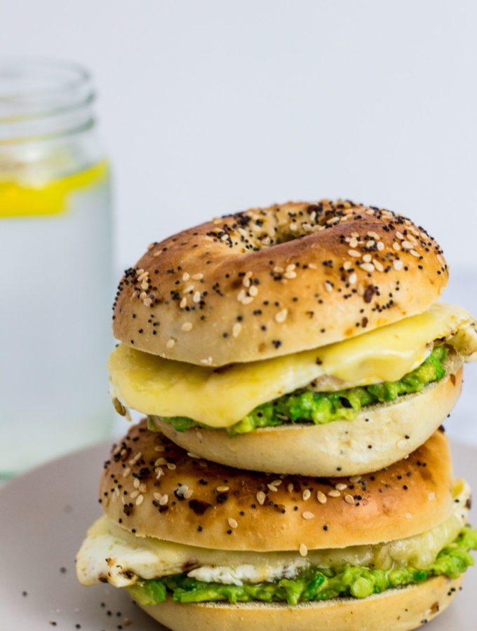 Straight shot of two bagel sandwich stacked on top of each other