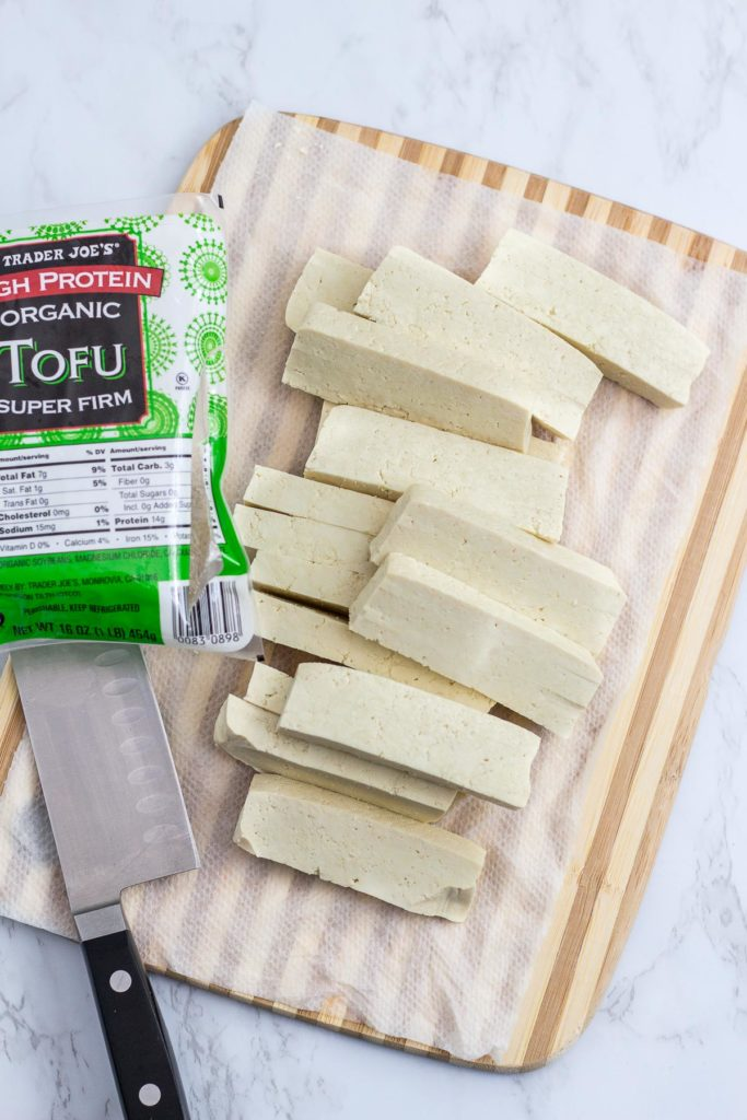 Over head shot of cut up tofu on the cutting board