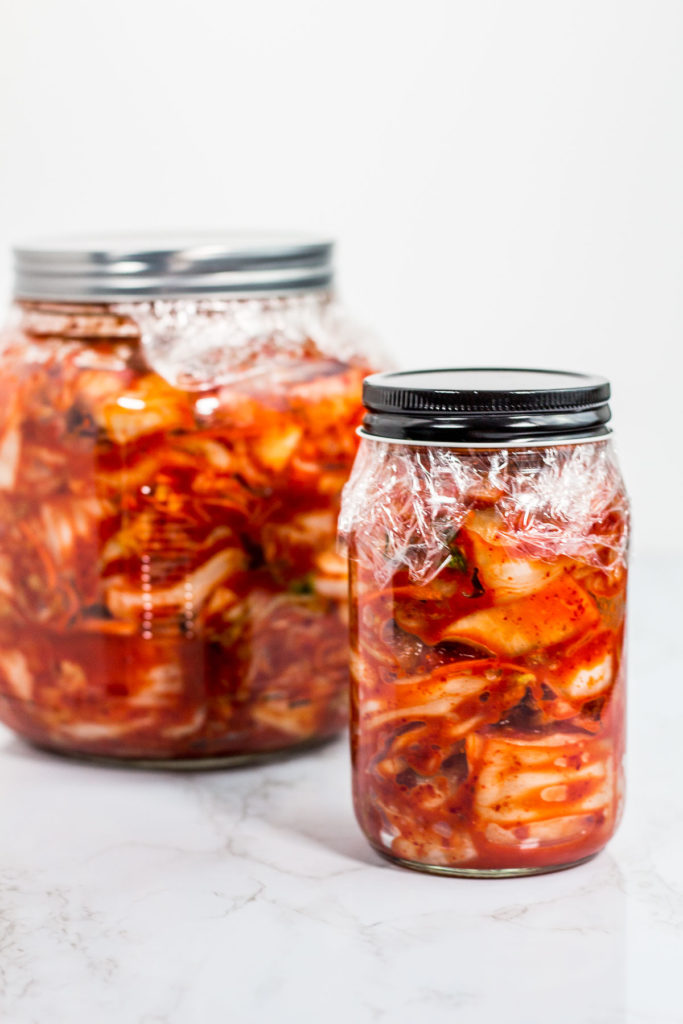 Glass jars of prepared kimchi, ready to be fermented