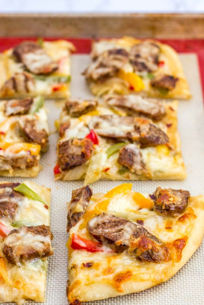 picture of vegan sausage pepper and onion pizza