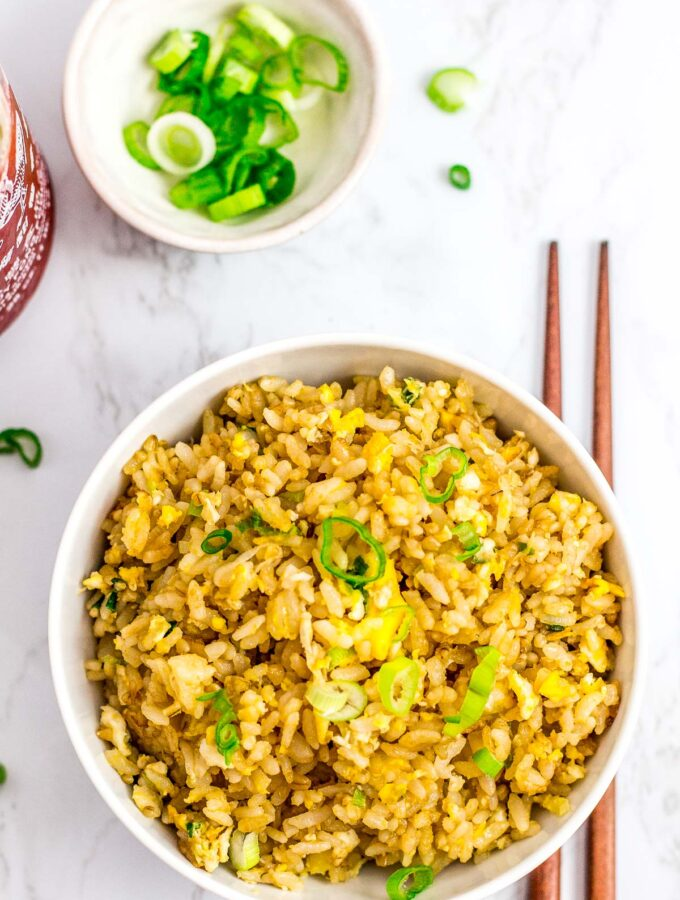 a bowl full of super easy 5 ingredients egg fried rice