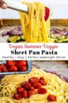 Holding spaghetti noodles with tongs over vegetables on the sheet pan.