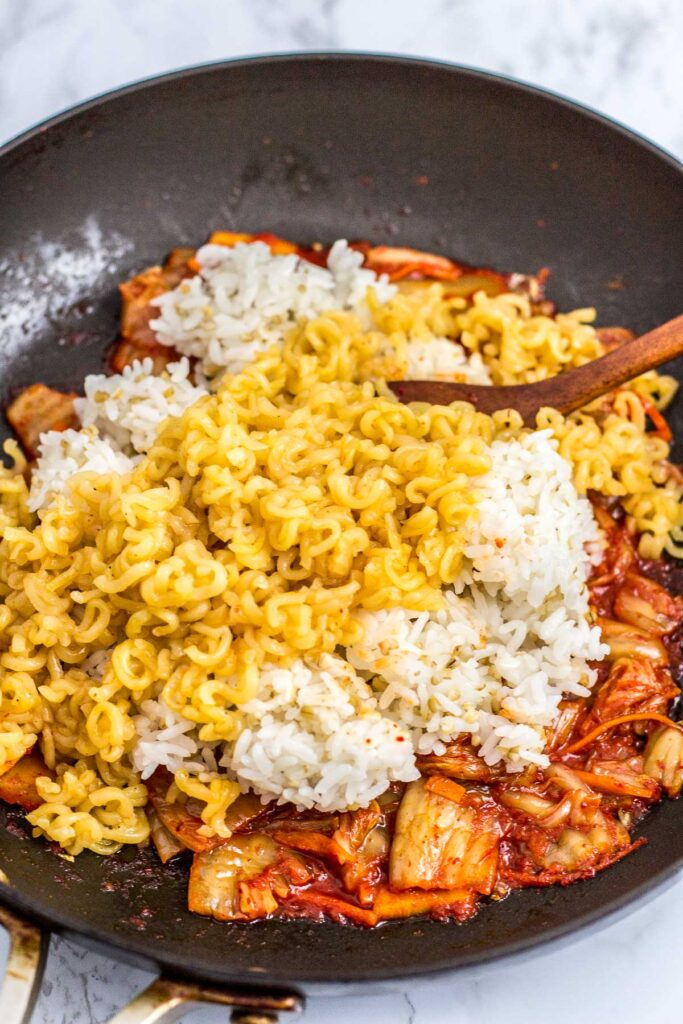 In the process of making the fried rice - once the rice and ramen is dumped on top of fried kimchi