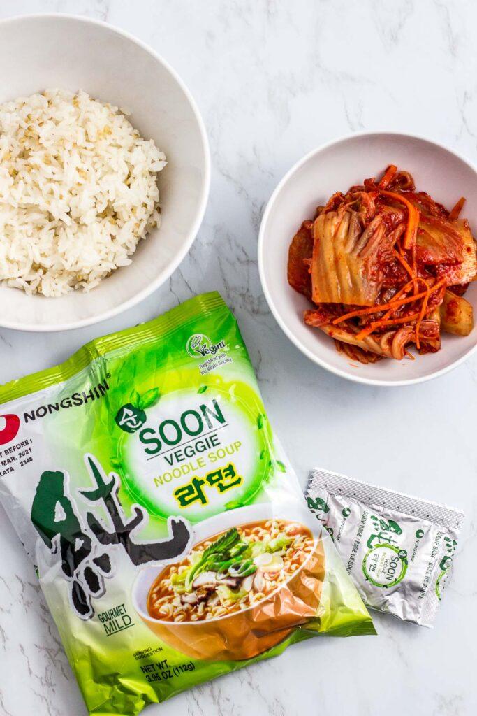 Ingredients to make the fried rice - rice, vegan kimchi and vegan Korean ramen