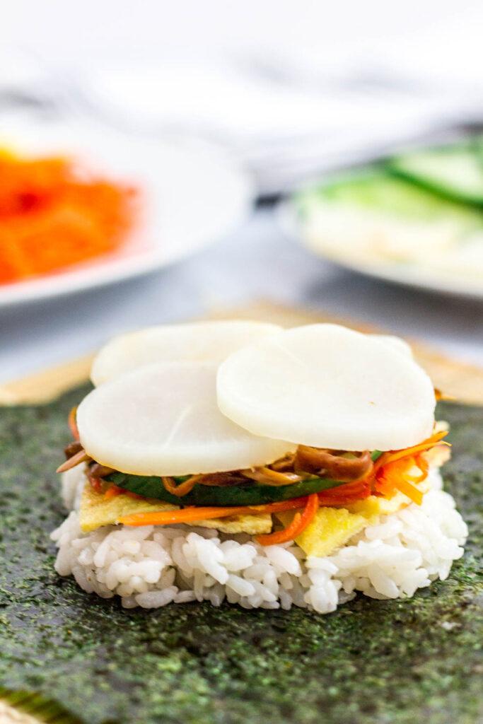 in process of making kimbap rice sandwich