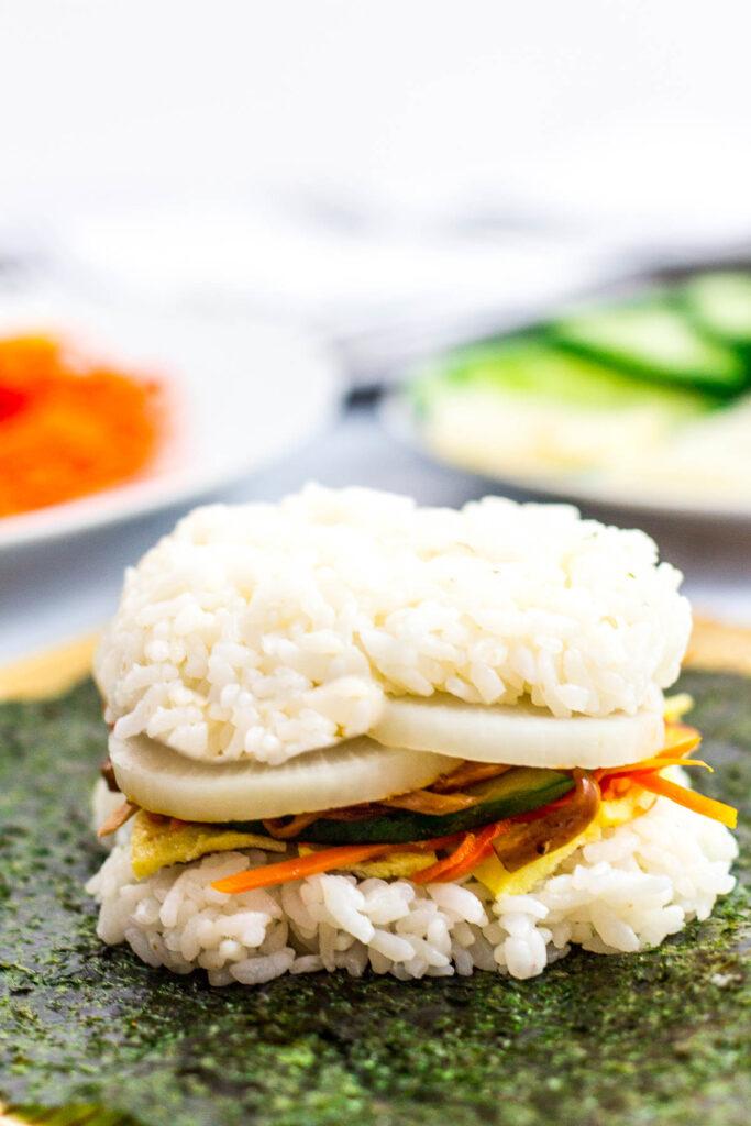 Kimbap rice sandwich on top of nori