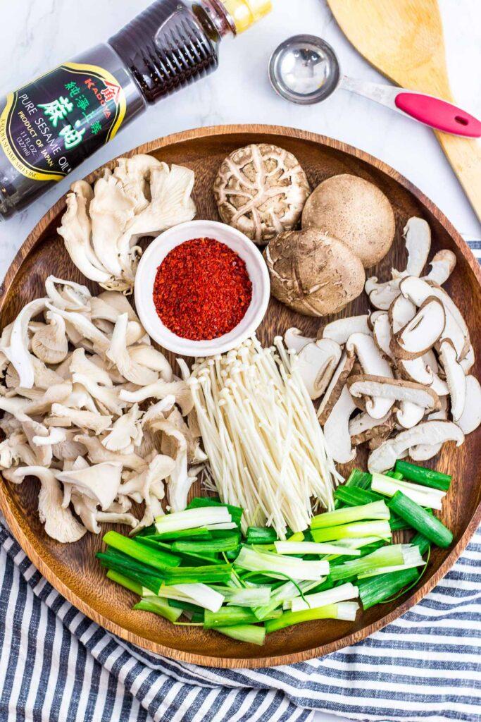 oyster, enoki, shiitake mushrooms, green onion, Korean chili pepper, and sesame oil