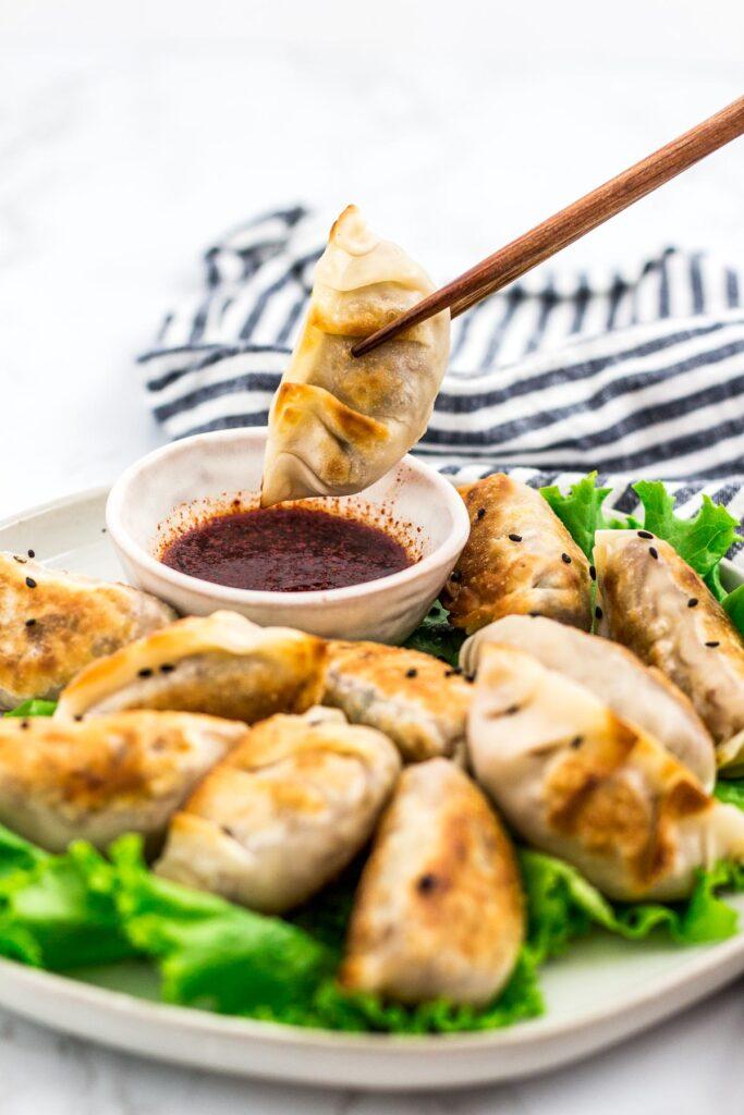 About to dip a mandu/dumpling into a sauce
