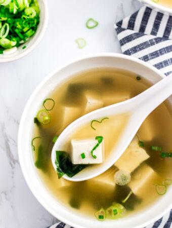 vegan miso soup with green onion garnish