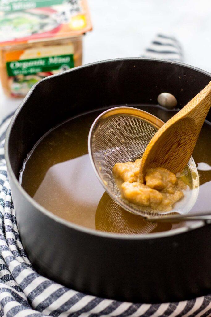 Dissolving miso into vegan dashi broth