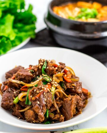seitan bulgogi, vegan Korean bean paste soup and lettuce in the background