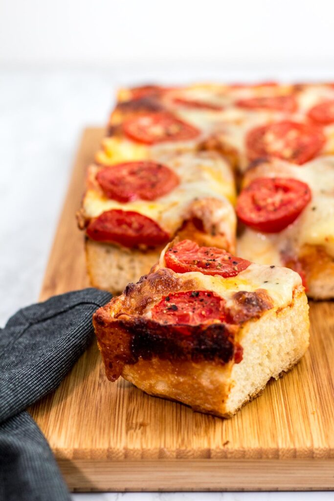 Close up shot of a piece of Detroit style pizza