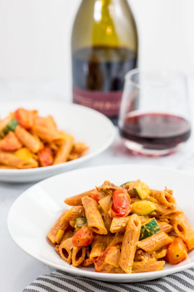 Vegetable filled healthy vegan creamy lentil pasta primavera
