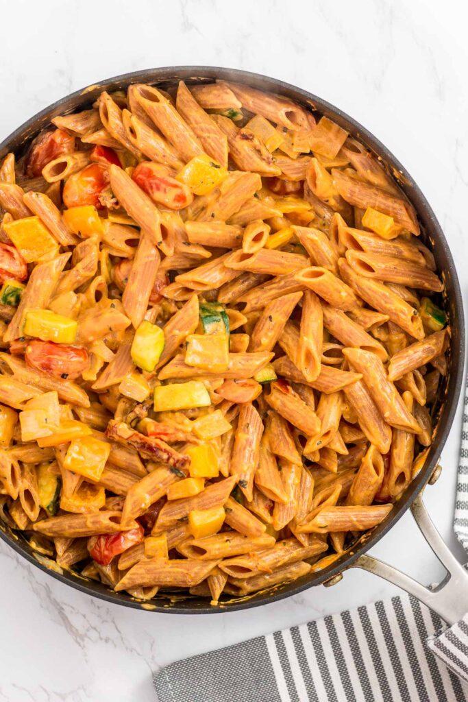 Overhead shot of creamy pasta primavera in the skillet