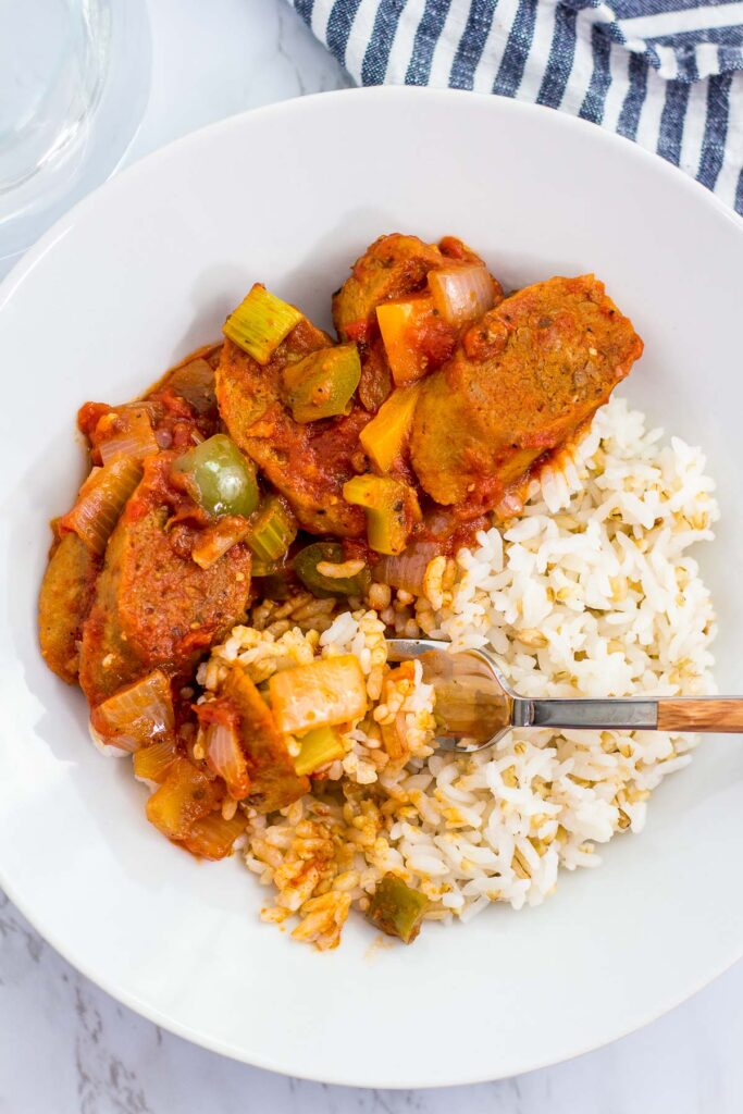 overhead shot of close up of vegan creole sausage cacciatore over rice