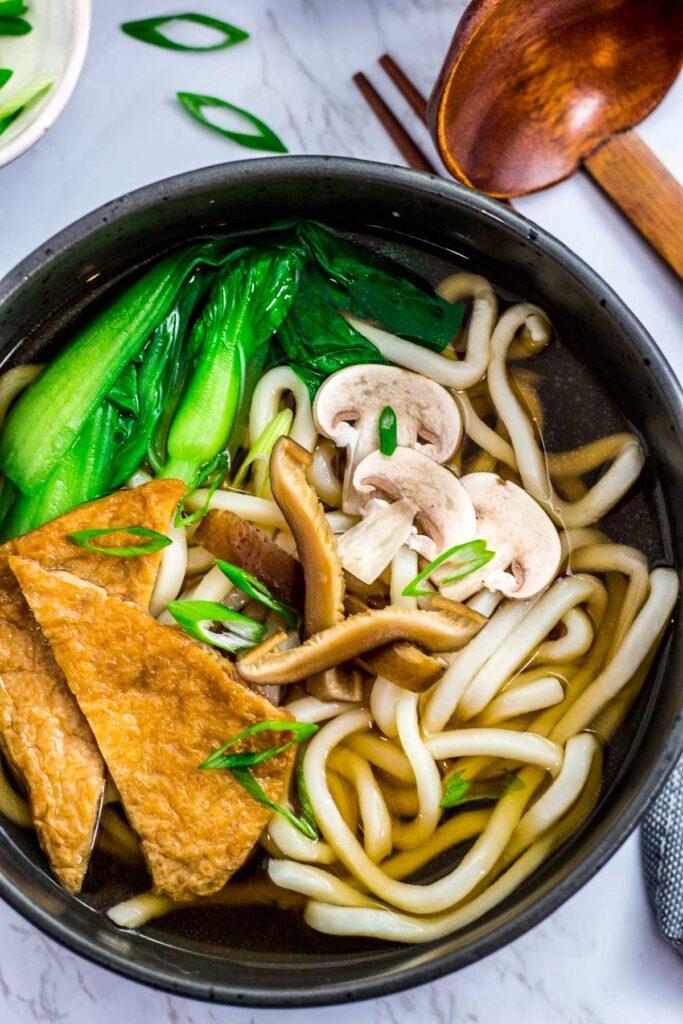 Close up shot of vegan udon noodle soup