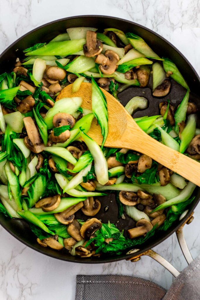 cooked bok choy and mushroom in the pan