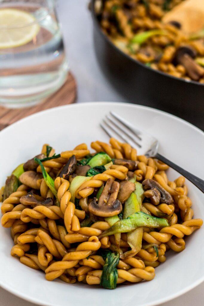 Close up photo of bok choy mushroom pasta stir fry
