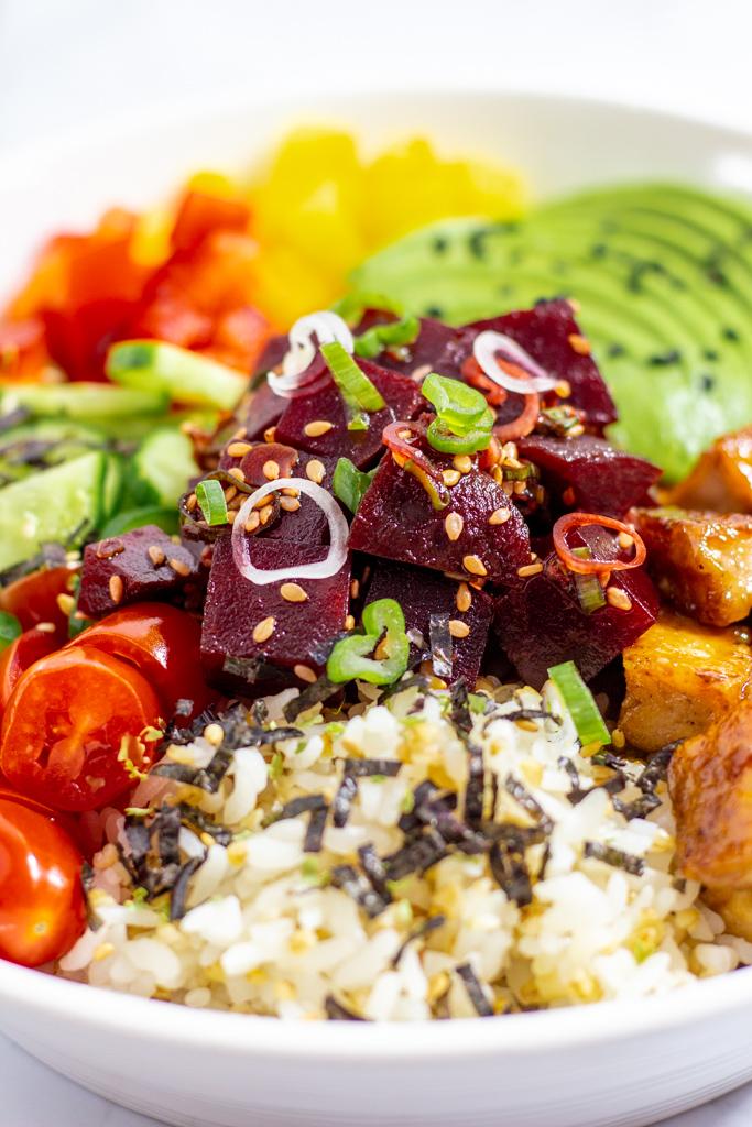 close up photo of vegan marinated beet poke bowl