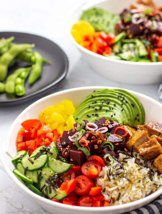 two bowls of vegan beet poke bowls