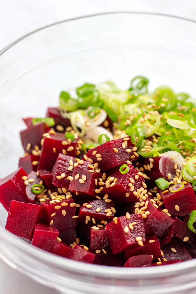 diced beets, green onion, and sesame seeds in a bowl