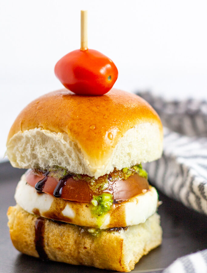 close up shot of caprese cold sliders with balsamic glaze