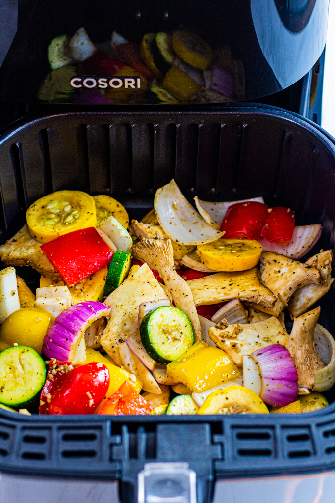 close up photos of vegetables in Cosori air fryer basket
