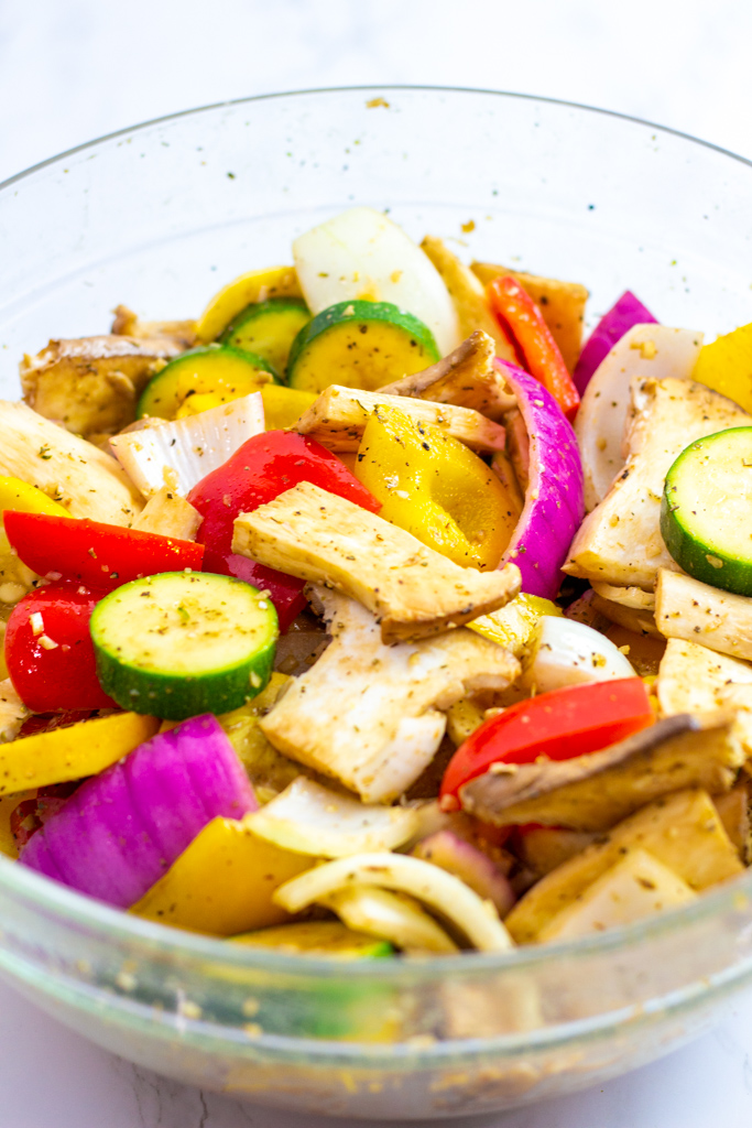 marinated vegetables in a large clear bowl
