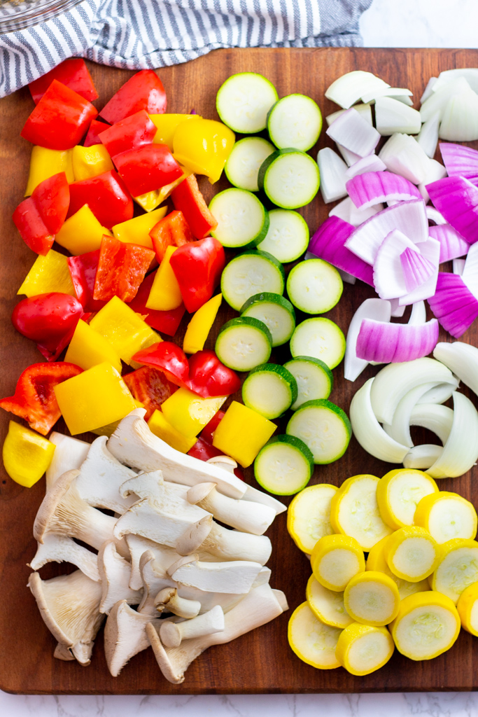 cut vegetables on a wooden board before marinade