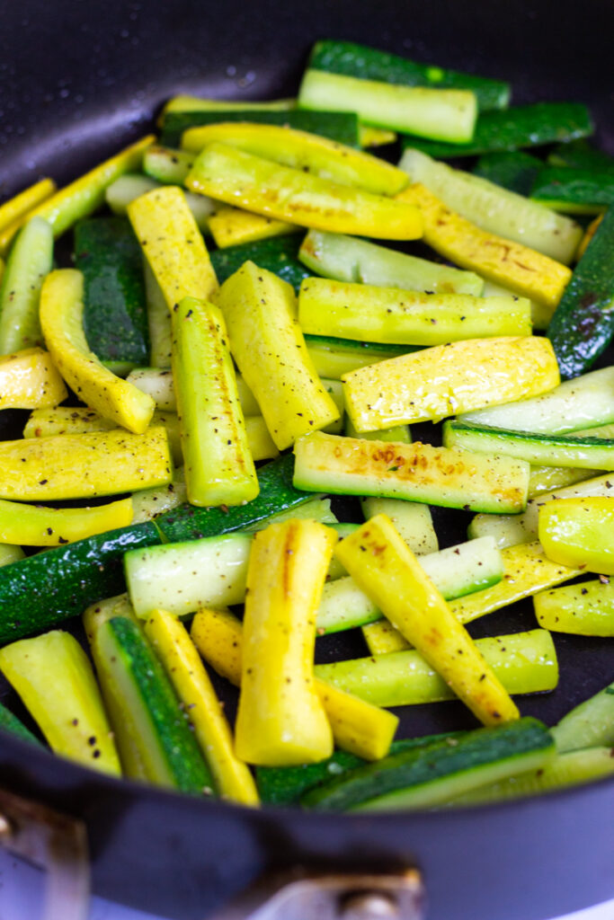 sauteed zucchini and yellow squash in a non-stick pan seasoned with black pepper