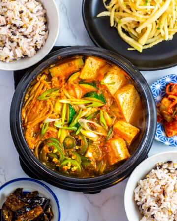 doenjang jjigae with other korean side dishes and rice.