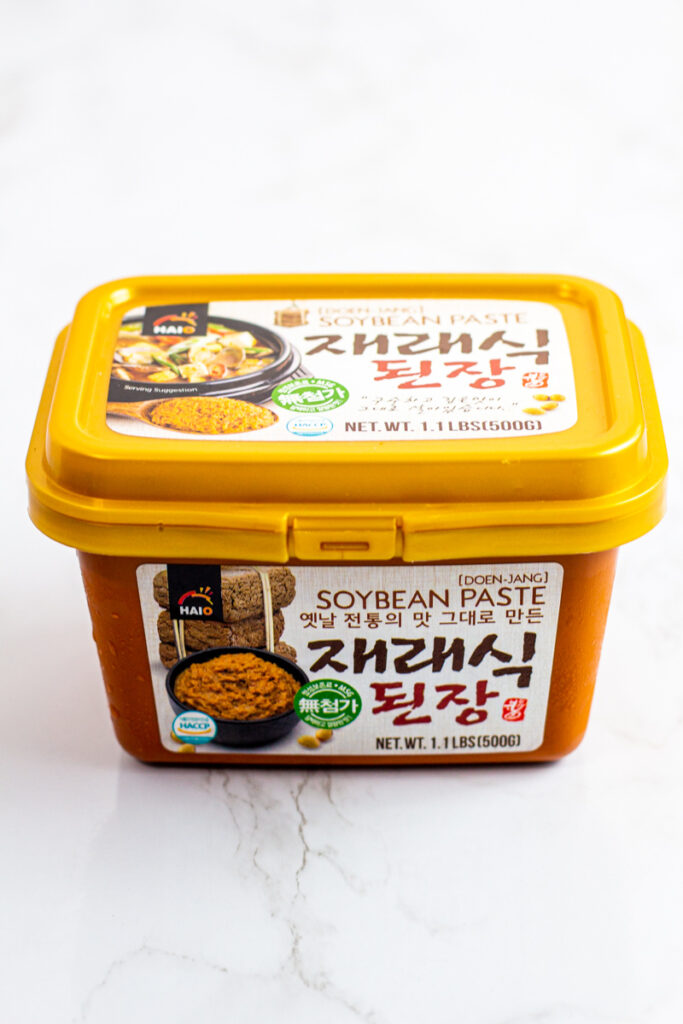 photo of a store-bought doenjang (soybean paste).