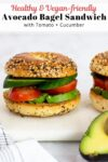 avocado bagel sandwich with tomato and cucumber.