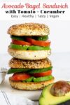 two stacked avocado bagel sandwiches.