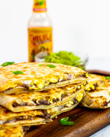 cut breakfast quesadillas with refried beans and eggs.