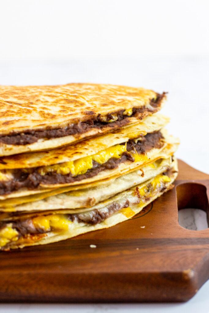 breakfast quesadillas on a wooden board.