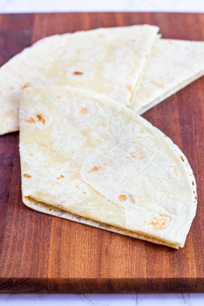 folding a large flour tortilla in 3.