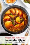 overhead shot of Vegan Soondubu jjigae with other Korean side dishes around.
