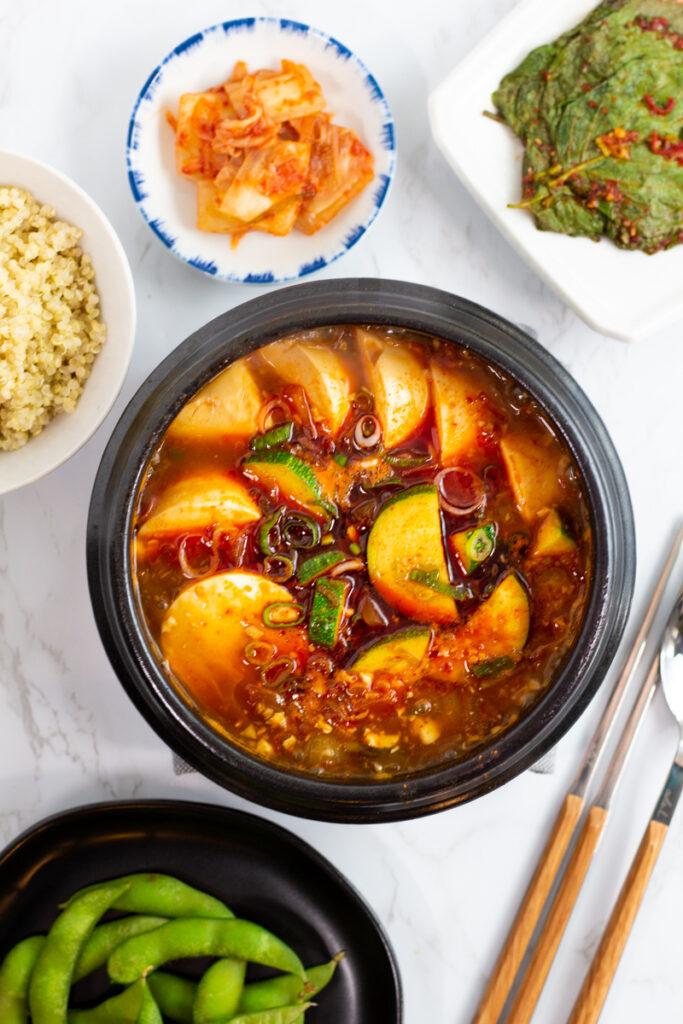 other side dishes are around vegan soondubu jjigae.